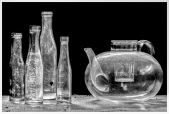 Glass items found and photographed under window light at an abandoned farm. (ducatidave60) Tags: blackandwhite bw abandoned monochrome fuji decay fujifilm dereliction vintagebottles glassteapot fujifilmxpro1 fujinonxf60mmf24macro