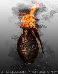 Gods Grenade (Jennifer Gleason) Tags: metal photomanipulation fire war cross smoke explosion manipulation holy weapon cracks grenade embers destroy molten combustion dogtag holywar goldgrenade godsgrenade fireygrenade