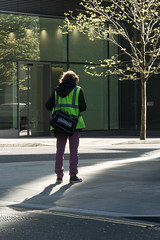 Sunny corner (Spannarama) Tags: street uk shadow sunlight man london sunshine standing bag moorlane ropemaker highvis