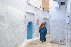A woman walks through Chefchaouen's Blue Medina (adventurousness) Tags: bluecity chefchaouenthebluepearl thebluecity blue chaouen chefchaouen morocco street travel medina woman