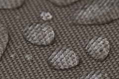 An Archipelago of Raindrops on a Sea of Waterproof Fabric (brucetopher) Tags: macromondays clothtextile rain waterproof water bead beading drop droplets rainwater drip three 3 cloth textile fabric