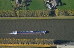 Above the canal boat (Vee living life to the full) Tags: sky cloud clouds blue storm rain rainbow colours amsterdam netherlands holland amstel canal river boat ship cargo tanker bridge land helicopterview birdseyeview distance marine marina fields patchwork airfield airport aeroplane carriers planes transport people network water treatment works landscape picture porthole view nikond300 2016 november holiday weekend travel tourism tourist placestovisit traveller pleasure flying flight