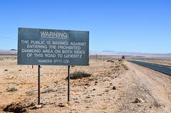 Warning against entering the Sperrgebiet, Namibia (jbdodane) Tags: africa ausluderitzroad bicycle cycletouring cycling cyclotourisme day631 desert diamond mining namibia road sign sperrgebiet velo warning freewheelycom b4 jbcyclingafrica
