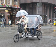 Keeping Dry on a Wet Day ! (AndrewHA's) Tags: london westminster rain bicycle rickshaw