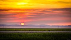 on fire - Explored!! (achinthaMB) Tags: sunset sun canada mountains calgary clouds rockies dusk farm farmland alberta waterton pinchercreek canadianrockies watertonlakesnationalpark canonrebelt2i