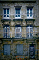 (Artypixall) Tags: door windows urban france building architecture facade shutters balconies desaturated libourne aquitaine placeabelsurchamp