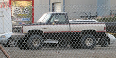 '84 GMC 4X4 (Eyellgeteven) Tags: old black classic chevrolet truck vintage fence silver nice gm shiny 4x4 gray pickup pickuptruck sierra chainlink chevy 1984 vehicle modified fencing 1980s gmc madeinusa americanmade fourwheeldrive lifted chev generalmotors twotone fencedin 12ton generalmotorscorporation shortbed sierraclassic eyellgeteven