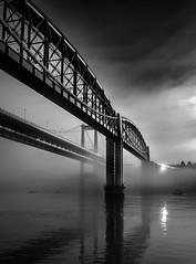Tamar Bridges in Mist (Mick Blakey) Tags: rivertamar saltash tamarbridges foggy bridge river railway mist brunel engineer fog engineering misty landscape blackwhite