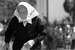 The old lady with a white scarf going home from the church on a sunny sunday, at noon (Cristian Ştefănescu) Tags: old portrait blackandwhite woman look lady scarf blackwhite eyes czech age romania frau portret minority ochi vecchio banat schal rumänien ritrato batic privire czechian bătrână vârstă bigăr böhmin cehoaica pemoaică