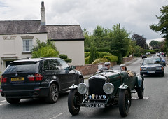 OLD MEETS NEW (Des Hawley. Over 1.9 million views !!) Tags: uk england people cars beautiful car nikon driving village cheshire outdoor gorgeous photojournalism vehicle procession veteran vintagecars d300 lymm deshawley lymmhistoricaltransportday