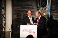 Board Member Gregory Rogers recieving the Ackerman Corporate Partner Award presented by John O'Neill