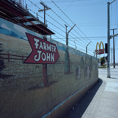 farmer john. vernon, ca. 2014. (eyetwist) Tags: california plant signs building green industry 120 6x6 mamiya film sign wall analog fence mediumformat painting square typography 50mm la losangeles bacon los wire mural downtown industrial factory angeles kodak quality packing icon ishootfilm meat mcdonalds pork sidewalk socal wires pigs signage processing type arrow analogue swine mamiya6 vernon portra barbed dtla slaughterhouse goldenarches typographic emulsion 160 farmerjohn primes f4l angeleno eyetwist kodakportra160 6mf mamiya6mf theicon ishootkodak epsonv750pro recentlyprocessedfilm filmexif filmtagger eyetwistkevinballuff mamiya50mmf4l