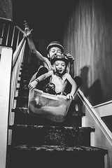 Stair Sledding by Ashlee Tomes, USA (childphotocompetition) Tags: boys childhood stair lifestyle happiness sledding laughter bwchildphotocontest