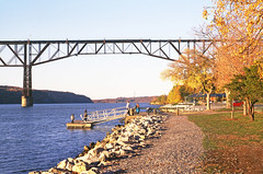 New Haven Railroad (former CNE) view detailing a portion of the out of service Poughkeepsie Railroad Bridge across the Hudson River is seen from Waryas Park at Poughkeepsie, New York, Fall 2002 (alcomike43) Tags: old city bridge newyork color classic water vintage river photo downtown slide trains historic cne photograph hudsonriver freighttrains railroads passengertrains newhavenrailroad waryaspark nhrr poughkeepsierailroadbridge nynhh highlandnewyork poughkeepsienewyork maybrookline centralnewengland walkwayoverthehudson maybrooknewyork steelcantileverdecktrussbridge