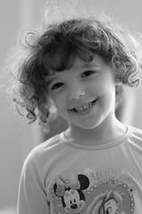 Young girl smiling (domturner) Tags: portrait white black film girl monochrome smile smiling pretty fuji child young halo curls simulation curly fujifilm jpg backlit jpeg fujinon greyscale f12 56mm xt1