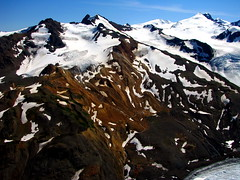 Mining Camp (Dru!) Tags: orange mountain snow canada mountains ice work bc northwest britishcolumbia peak mining glacier alpine geology exploration moraine geomorphology nass coastmountains geological unuk mineralized miningcamp gossan bell2 salmonglacier boundaryranges