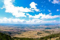 Korce, Albania (Ina Halimi) Tags: city blue sky white beautiful clouds canon photography town fisheye albania korce 500d korca