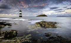 Puffin Penmon (Glynmoto) Tags: uk longexposure sunset sea lighthouse seascape blur water wales landscape rocks pebbles blackpoint anglesey puffinisland penmanpoint