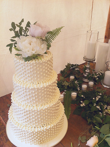 Buttercream Swiss Dot Wedding Cake with Fresh Flowers