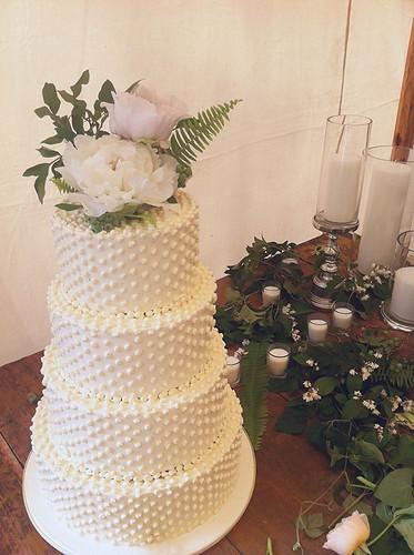 Buttercream Swiss Dot Wedding Cake with Fresh Flowers