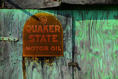 Quaker State (davidwilliamreed) Tags: hinge wood old abandoned sign metal rust lock decay neglected rusty forgotten weathered siding crusty patina