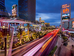 The Strip (clarsonx) Tags: longexposure light sign skyline night clouds landscape cosmopolitan downtown neon cityscape traffic cloudy lasvegas nevada billboard explore palmtrees trail strip bellagio bluehour planethollywood crosswalk pwcloudy