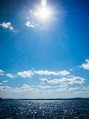 Pielinen (miemo) Tags: travel summer sky sun sunlight lake nature clouds finland landscape europe waves olympus lensflare ep1 lieksa pohjoiskarjala pielinen northkarelia bodycaplens olympus15mmf8