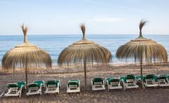 Thatch Umbrellas and Beach Chairs - Marbella, Spain (ChrisGoldNY) Tags: travel water canon poster spain sand europa europe mediterranean european forsale chairs andalucia espana spanish viajes posters beaches albumcover bookcover umbrellas bookcovers marbella albumcovers licensing chrisgoldny chrisgoldberg chrisgold chrisgoldphoto chrisgoldphotos
