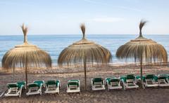 Thatch Umbrellas and Beach Chairs - Marbella, Spain