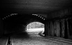 Road to Nowhere (Daniel_Allmark) Tags: road street city bridge light england white black building brick lines canon photography shot bend daniel tunnel where paving stoned leading 400d allmark