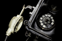 Close-up of an old black telephone (enolabrain) Tags: old black classic metal vintage idea call technology phone antique background telephone traditional dial retro communication number equipment concept calling past keypad receiver isolated rotary connect telecommunication obsolete revival dialer 30s