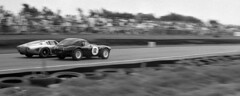 Goodwood Revival RAC TT Celebration Race by strobie42 - The AC Cobra of Ludovic Carron and Nicholas Minassian overtakes the Iso A3C of Jamie McIntyre and Bobby Verdon-Roe on the inside coming in to Madgwick corner.