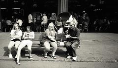 Sitting on a bench L_M6_7365 (erlin1) Tags: 25mmvl 2014 adults analog august bw bench blackandwhite fair film leicam6 mnstatefair teens tmax100film stpaul mn usa visible v1 v1bw