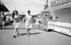 Holding Hands L_M6_7492 (erlin1) Tags: leica people blackandwhite bw usa film analog print outdoors couple statefair stpaul visible rodinal printed mn v1 tmax100 25mm 125 leicam6 2014 mnstatefair homedeveloped adonal 25mmvl