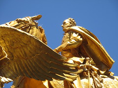 Civil War Statue General Sherman on Horseback with Angel 1354 (Brechtbug) Tags: street plaza new york city nyc roof cactus building green art yellow statue architecture angel bronze gold hotel leaf wings construction hands war pin afternoon shadows general near top flag fingers profile civil american underneath needles avenue 5th cushion sherman 59th the 06152014
