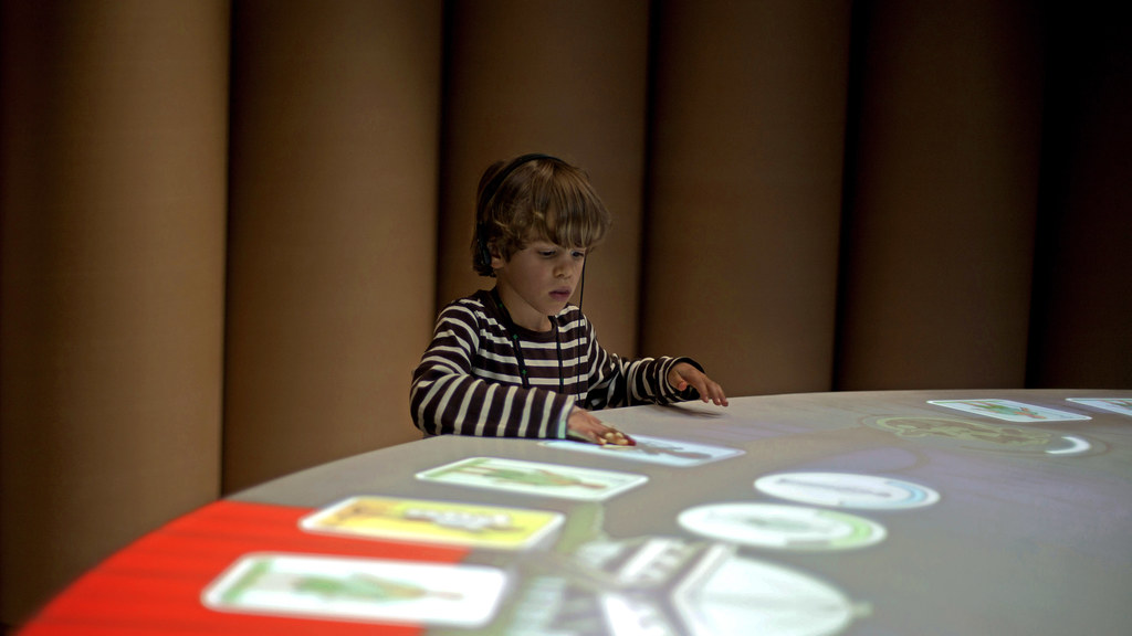 A child playing Hurricane at the Red Cross Museum