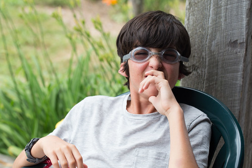 Jackson on the Lodge porch with goggles