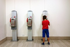 Using the hardline (escape from Matrix) (Ciccio Pizzettaro) Tags: blue red public three call phone row calling telecom lormat