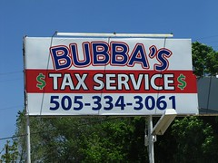 Bubba the tax man (jimsawthat) Tags: newmexico aztec smalltown taxservice plasticsigncover