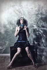 No Smoking (Spoken in Red) Tags: cigarette smoke smoking trunk blackhair bluedress barelegs sillyportrait womanportrait plumesofsmoke spokeninred womangagging