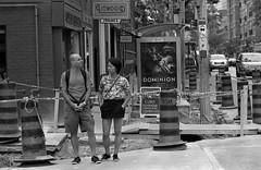 Oposite Ways (.:Axle:.) Tags: street people bw toronto ontario canada slr film blackwhite nikon kodak trix strangers streetphotography hc110 400tx f4 sliceoflife nikonf4 filmphotography kodaktrix400 dilutionb afdcnikkor105mm12d believeinfilm