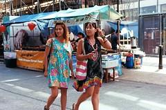 Sightseeing in Brick Lane (IanAWood) Tags: london candid streetphotography 35mmfilm shoreditch bricklane motheranddaughter eastend summerdresses summerinthecity contaxg2 kodakektar istillshootfilm notwalkingwithmynikon believeinfilm carlzeisst452forcontax