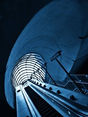 Blue Eye (Doug's Lumix) Tags: city uk blue england urban bw london monochrome architecture stairs underground subway mono metro britain escalator tube gb urbex