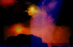 [ - BINARY SOLAR SYSTEM DEATH MATCH, TRONAmetric DATE - 4.523 BILLION YEARS AGO - ] (Tremor Saint) Tags: abstract redscale film sun suns colors redscalefilm binarysolarsystem binarysolarsystemdeathmatch 4523billionyearsago rematch filmrules multipleexposure tripleexposure testroll solar fd windmill tilting blue light leaks massiveimperfection charm lowficharm lomo lomograohy analogue analog holga 135 35mm holga135 analogalchemy sky trees earth trona wtf texas black mourning lowfi lofi pseudotherapy