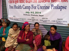 Waiting under the banner (The Advocacy Project) Tags: nepal camp people nature rural project justice women asia peace social womens medical health human rights medicine care fellowship fellows prolapse advocacy uterine