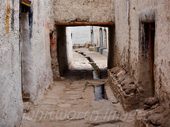Lo Manthang lane (whitworth images) Tags: street old nepal houses white water stone buildings town canal asia stream village mud path traditional nobody nopeople drain lane tibetan mustang himalaya narrow mudbrick whitewash paved restrictedarea uppermustang lomanthang annapurnaconservationarea
