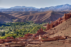 morocco village in dades valley (traveling-in-morocco.com) Tags: africa trees mountain rural outside outdoors golden countryside rocks wide arabic morocco atlas arabian kasbah dades