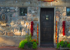 Santa Fe, New Mexico (RelaxByTravel) Tags: door red usa plant newmexico santafe flower chili gallery cross artgallery decoration holy galleries adobe idol northamerica holycross canyonroad