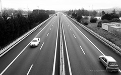 Highway, Italy {explored} (jev) Tags: leica blackandwhite italy cars monochrome highway wide rangefinder wideangle super m8 21mm 10000000 avenon leicam8 10007000 10007001 wwwartqcom
