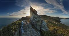 Pointing at the sky (Mark Frost :)) Tags: uk blue sunset sea sky panorama cliff sun rock clouds start point landscape coast rocks pano cliffs devon shore granite coastline pan startpoint